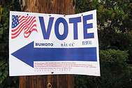 sign pointing to voting site