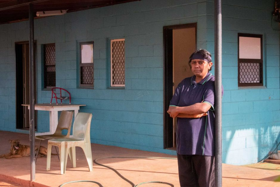 Jasmine Cavanagh, an Eastern Arrente woman and resident of Santa Teresa standing out the front of her house.