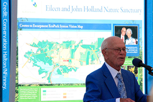 Photo of John Holland in front of Eileen and John Holland Nature Sanctuary. Photo by Nigel Finney.