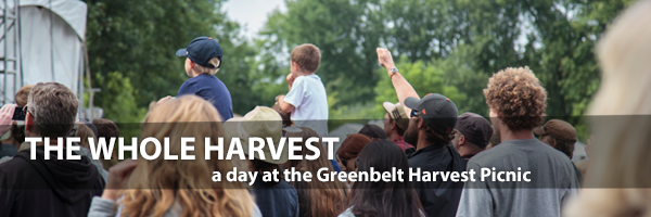 Photo - A crowd scene at the 2014 Greenbelt Harvest Picnic, from behind. Text overlay - THE WHOLE HARVEST: a day at the Greenbelt Harvest Picnic