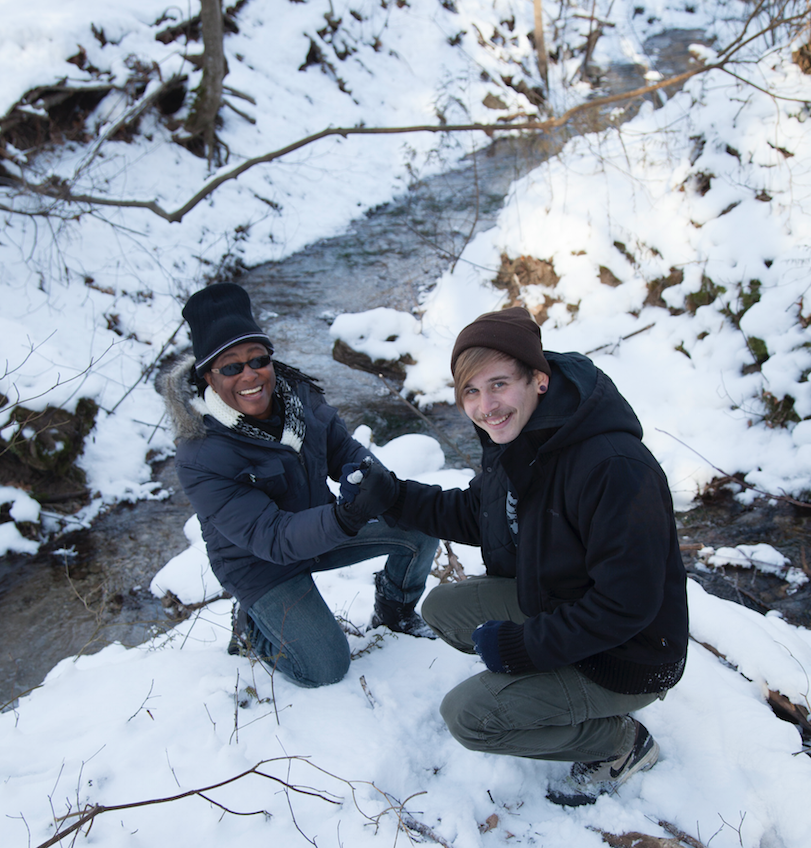 Janice and Nils pose beside a snowy stream in Orangeville