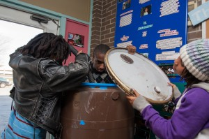 KI Eco Center youth entrepreneurs assemble a rain barrel prototype.