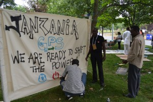 Members of Tanzania's Powershift team ready a banner for a march again coal in Turkey.