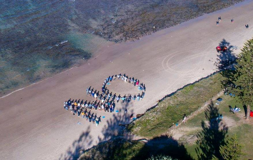 NO formed by people on Lennox Head beach to protest against a proposed sand mine at Newrybar Swamp Rd Lennox Head