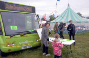 Bus next to solar panels at Wood Festival