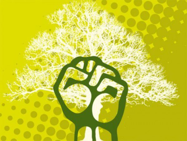 A green background with a white tree and a white fist coming up in front.