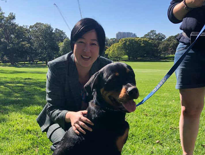 Image of Jenny Leong with a Rottweiler dog.