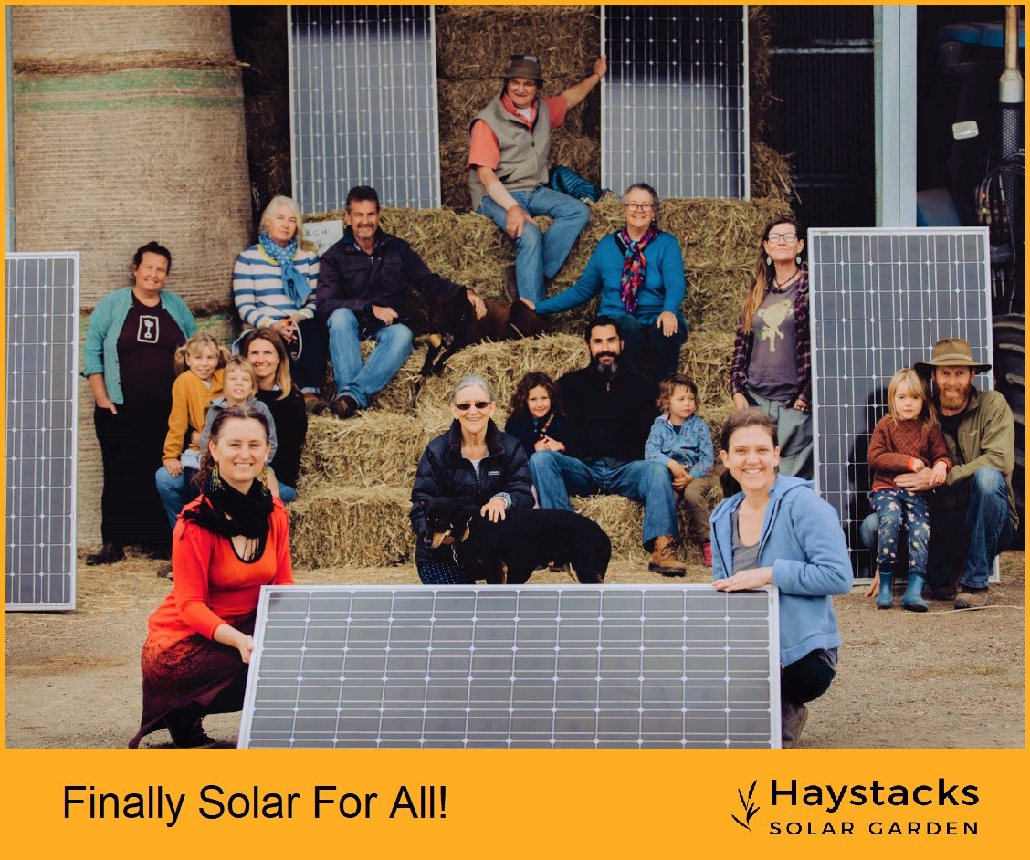 Image of Haystacks Solar Garden supporters pictured with solar panels and hay-bales.
