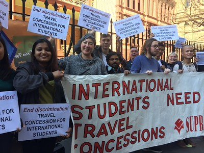 Jenny Leong MP with International students outside Parliament protesting travel concession.