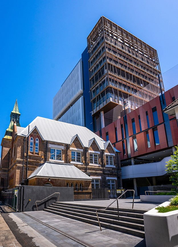 Photo of the front of the Inner Sydney High School showing the original building and new building behind.