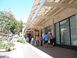 Visitors stroll at Stanford Shopping Center