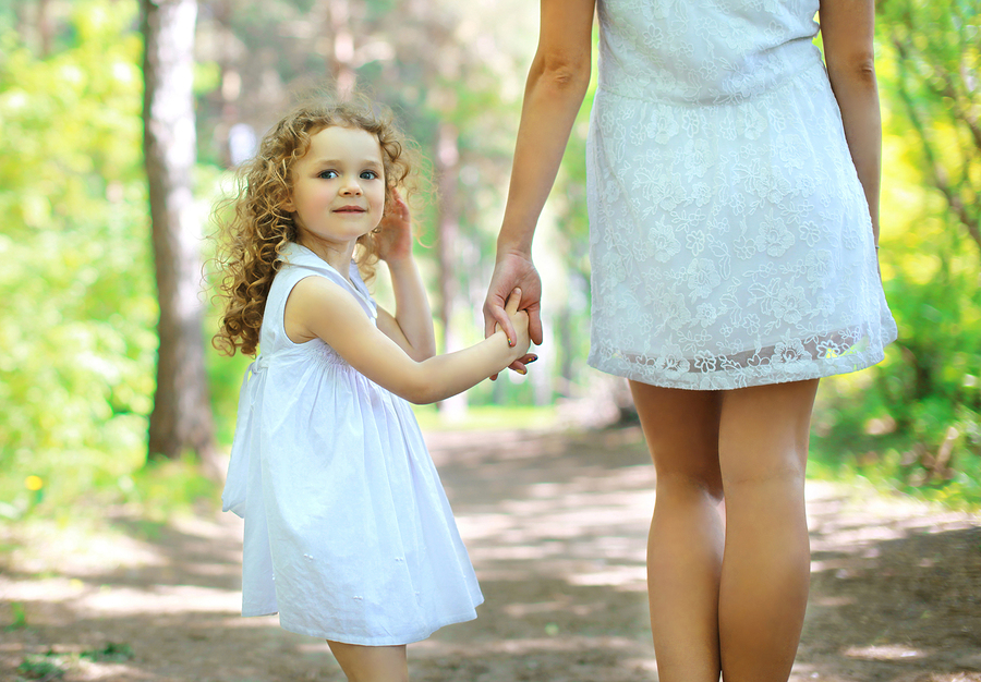bigstock-Cute-Curly-Girl-Walking-With-M-75590914.jpg