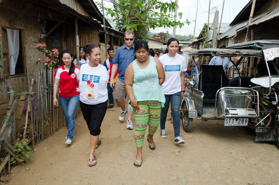 c_Molly-Feltner_Handicap-International__Rizal_Jessica_Walks_with_beneficiary_down_the_street.jpg
