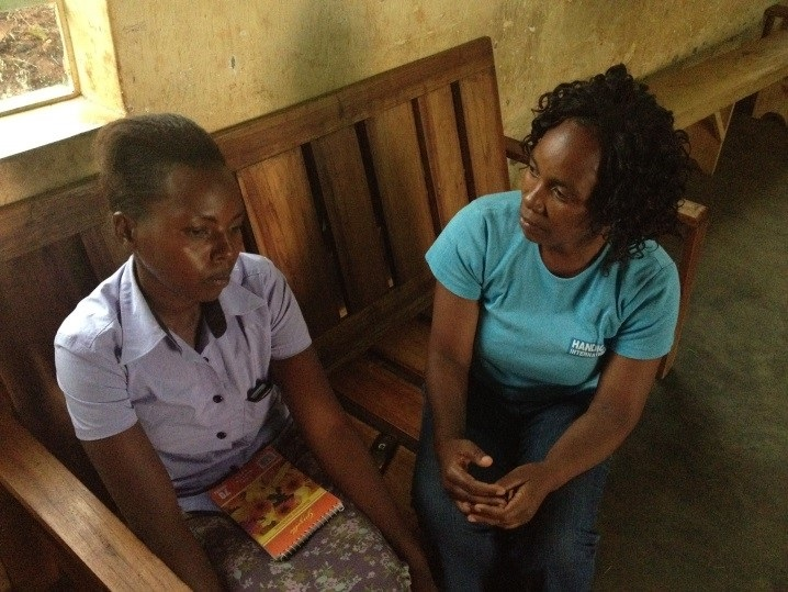 c_Wendy-Huyghe_Handicap-International__Two_women_sit_during_a_therapy_session_in_Rwanda.jpg