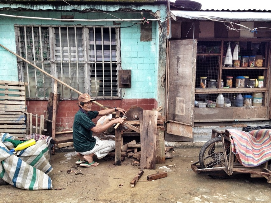 c_Camille-Borie_Handicap-International__a_man_begins_to_clean_up_after_Typhoon_Hagupit.jpg