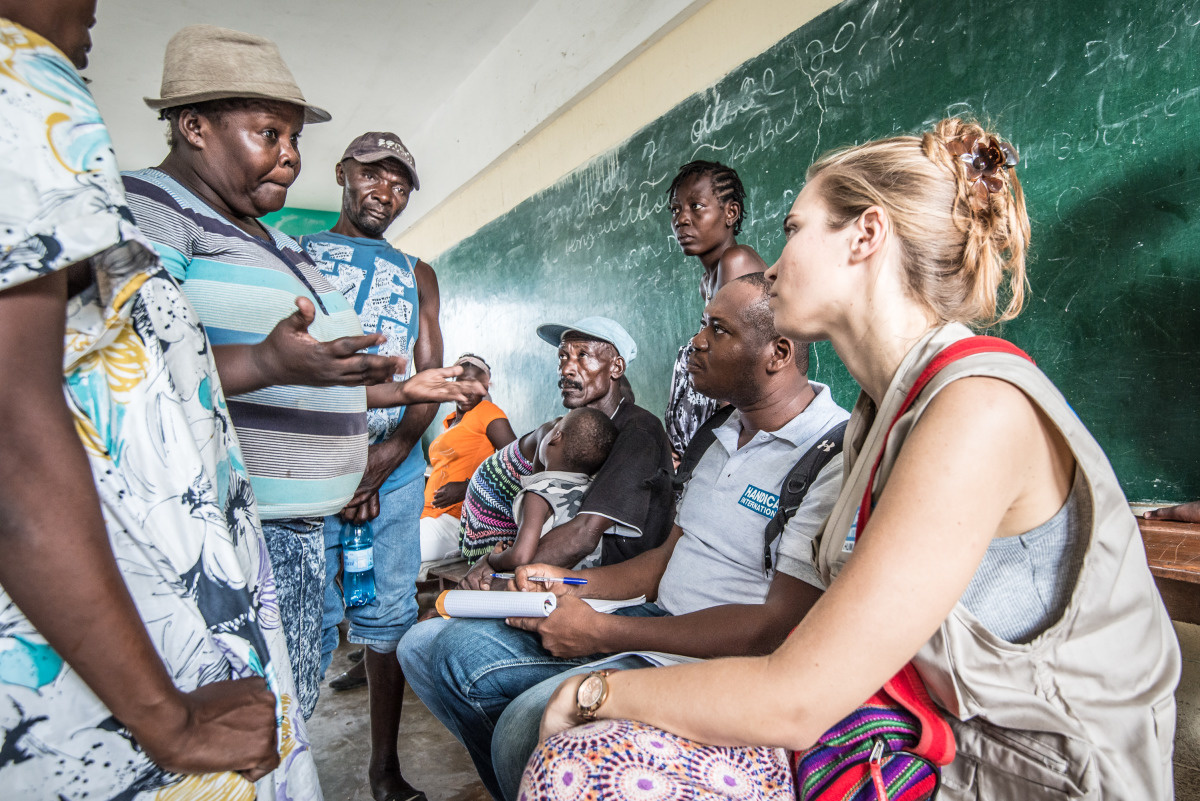 c_Benoit-Almeras_Handicap-International__HI_staff_talk_with_Haitians_in_a_local_school_that_acts_as_a_shelter_for_those_without_homes_following_Hurricane_Matthew.JPEG