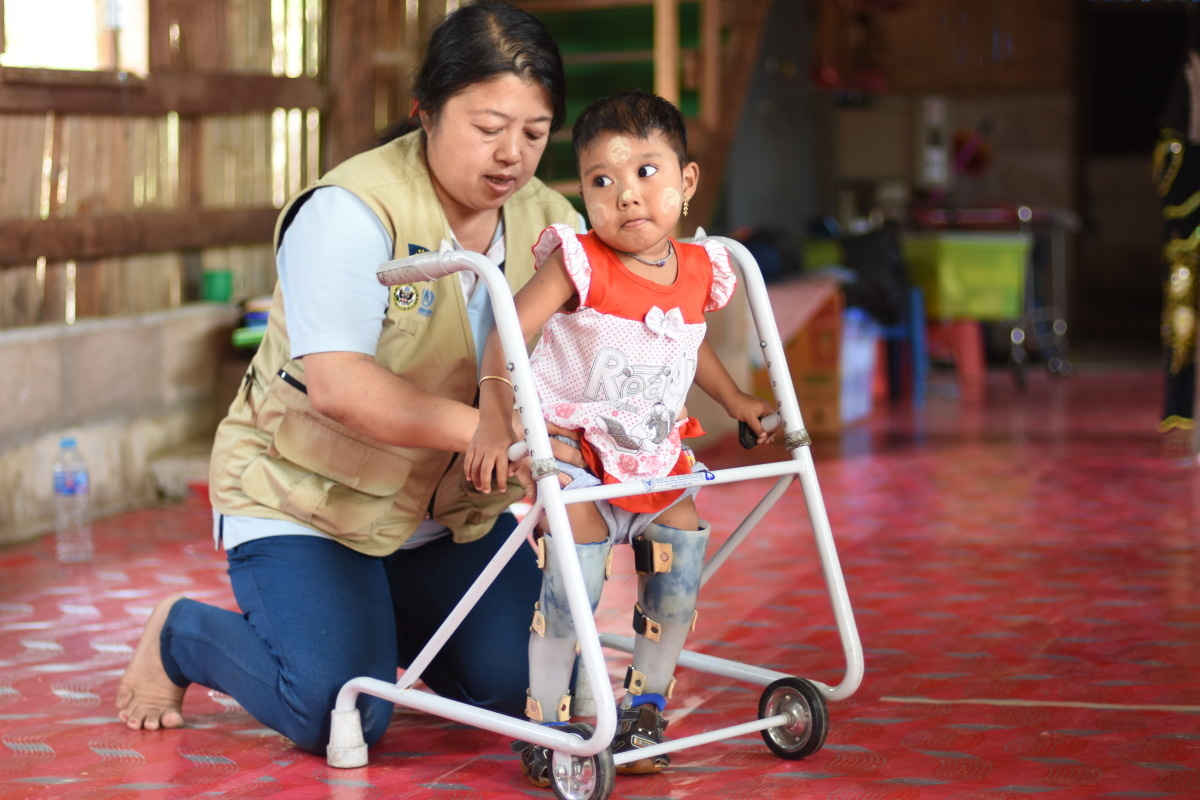 c_A-Jacopucci_Handicap-International__HI_staff_Noreen_helps_Djamila_from_Thailand_learn_to_walk_using_a_mobility_device.jpg