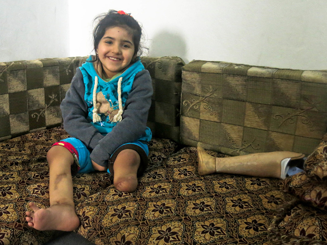 c_E-Fourt_Handicap-International__Salam_from_Syria_smiles_after_receiving_physical_therapy_from_Handicap_International_in_Jordan.jpg