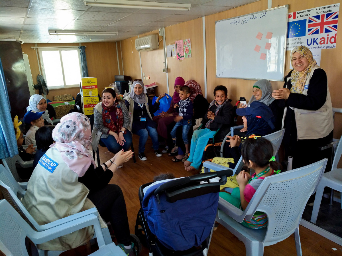 c_Elisa-Fourt_Handicap-International__Ahmed_and_other_children_with_disabilities_participate_in_a_group_activity_at_the_Handicap_International_rehab_center_in_Jordan.jpg