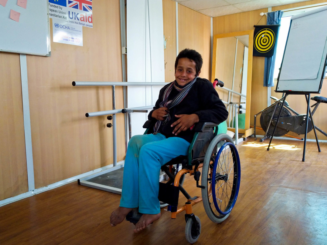 c_Elisa-Fourt_Handicap-International__Ahmed_smiles_in_his_wheelchair_at_the_Handicap_International_rehab_center_in_Jordan.jpg