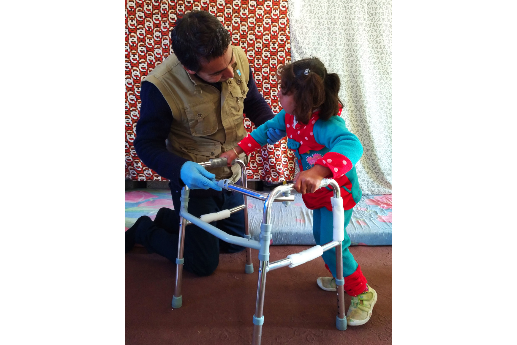 A six year old girl with cerebral palsy receives physical therapy from a Handicap International physical therapist in Iraq.