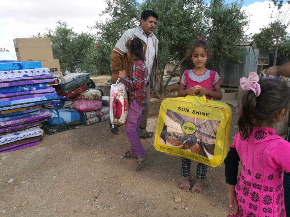 Providing assistance to displaced Syrians