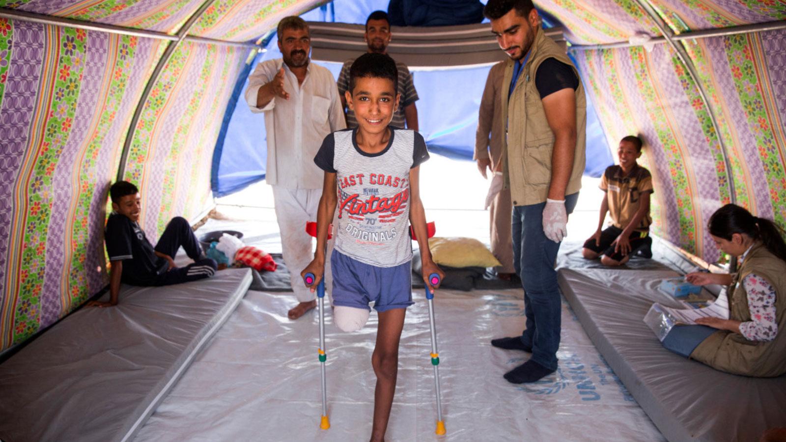 Abdel Rahman 12 stands tall thanks to HI's rehabilitation team in Iraq