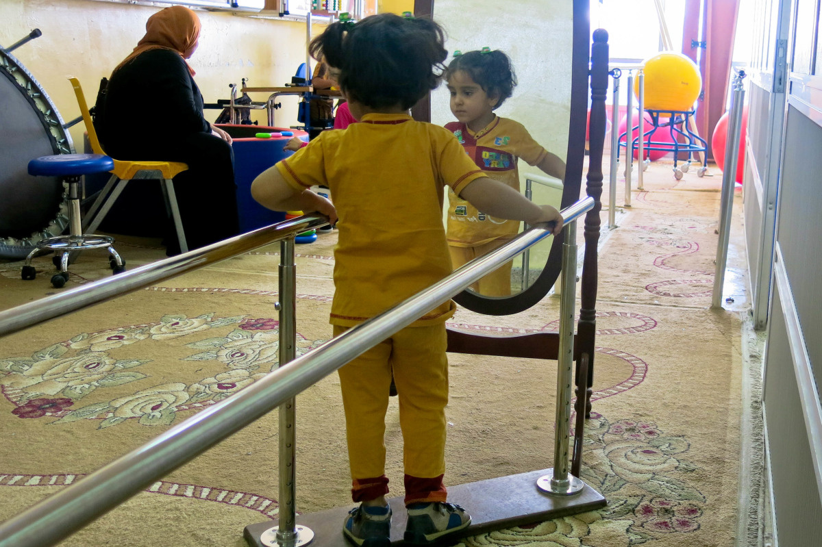 c_E-Fourt_Handicap-International__Five_year_old_Shams_receives_physical_therapy_sessions_at_an_IDP_camp_in_Iraq.jpg