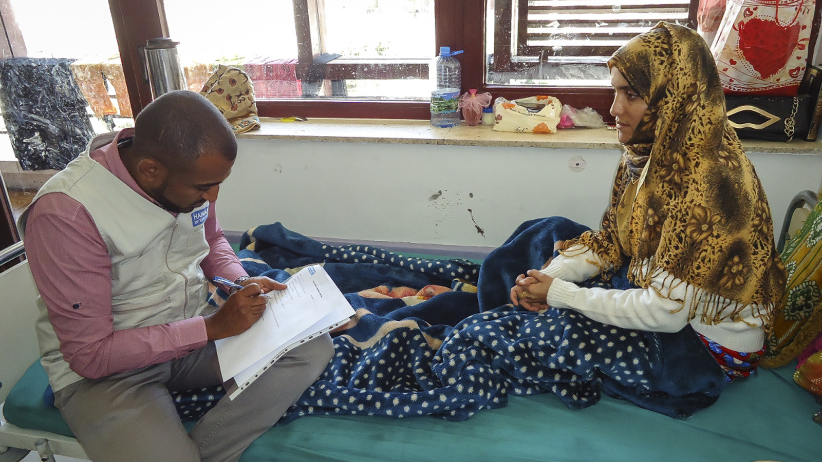 Bushra receives physical therapy from Handicap International in Yemen