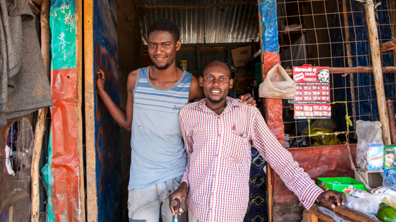 two-men-standing-outside-of-their-home-in-Somalia