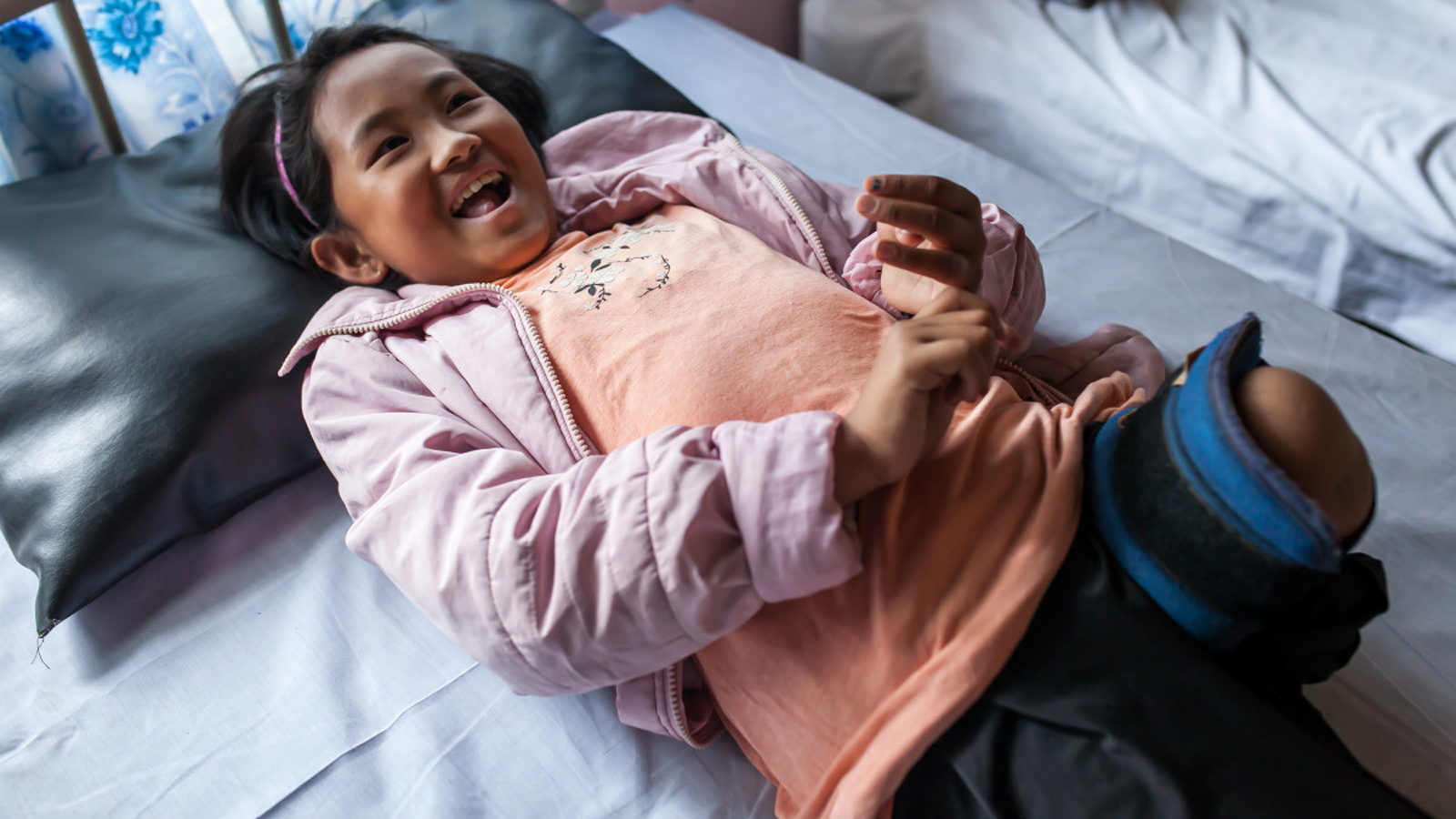 Khendo receives physical therapy at the rehab center in Nepal