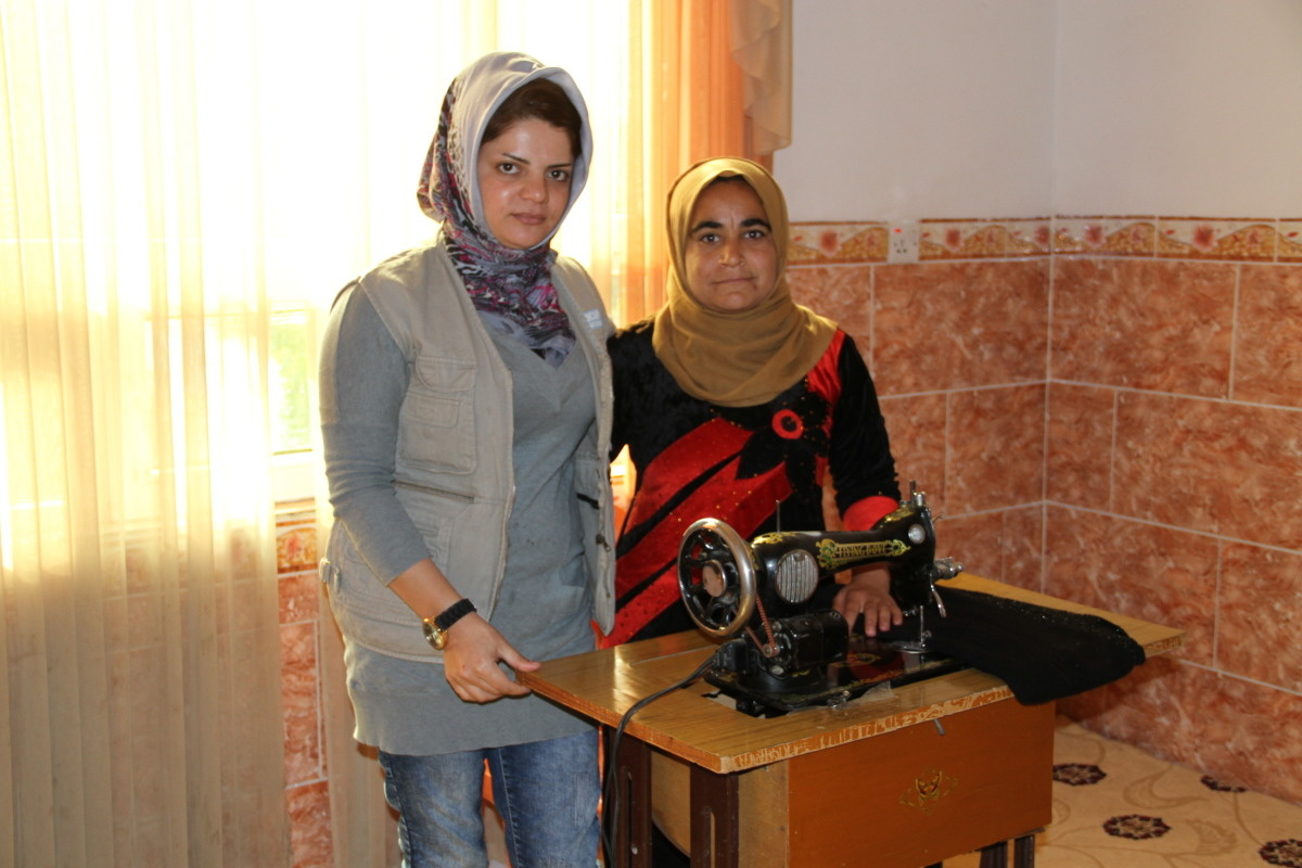 c_E-Fourt_Handicap-International__Payam_stands_with_an_HI_staffer_in_front_of_her_sewing_machine_in_Iraq.jpg