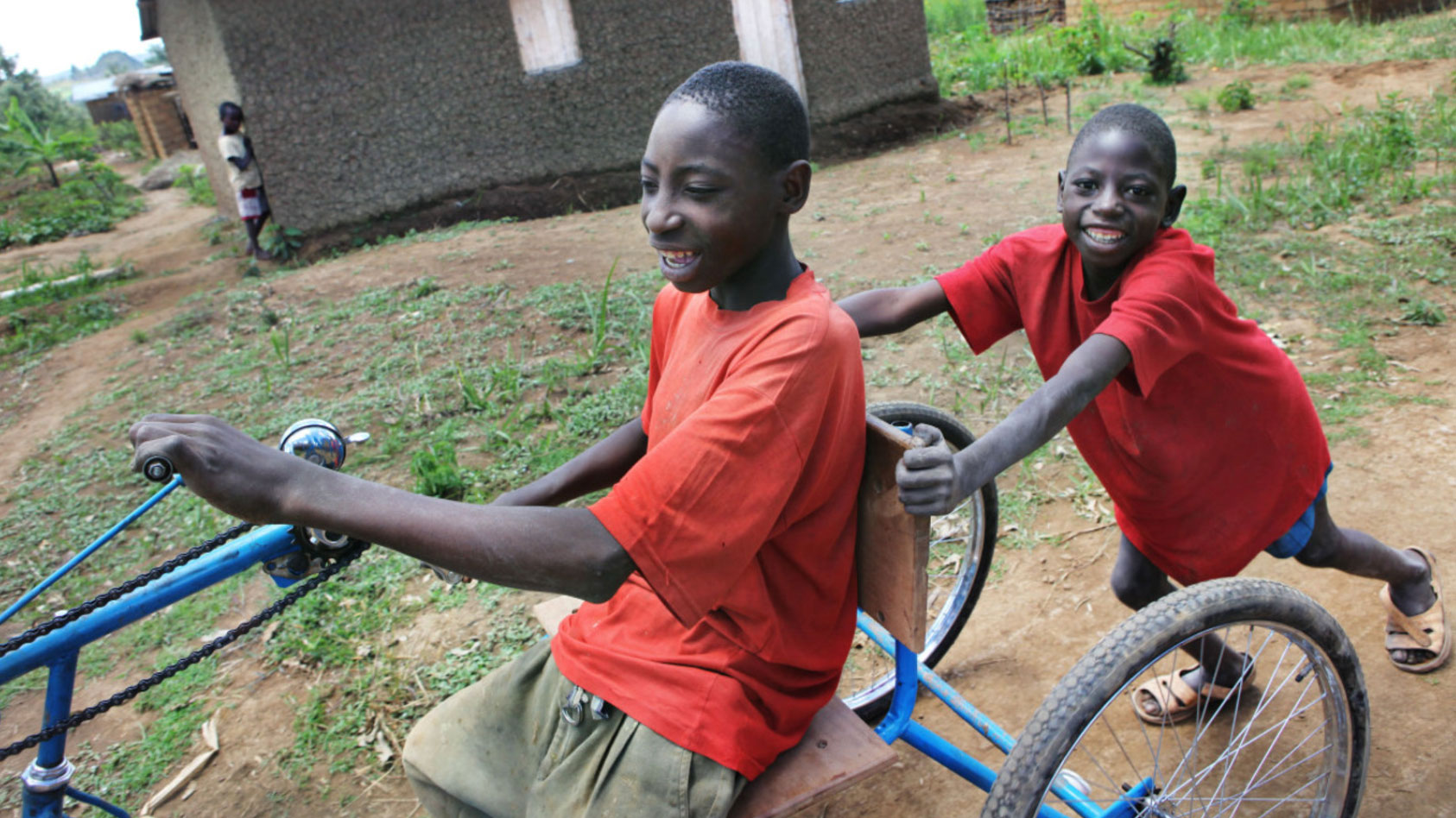two-boys-playing-on-a-bike-in-Tanzania