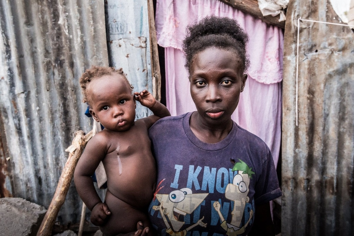Haiti_Benoit_photo_of_woman_and_baby.JPEG
