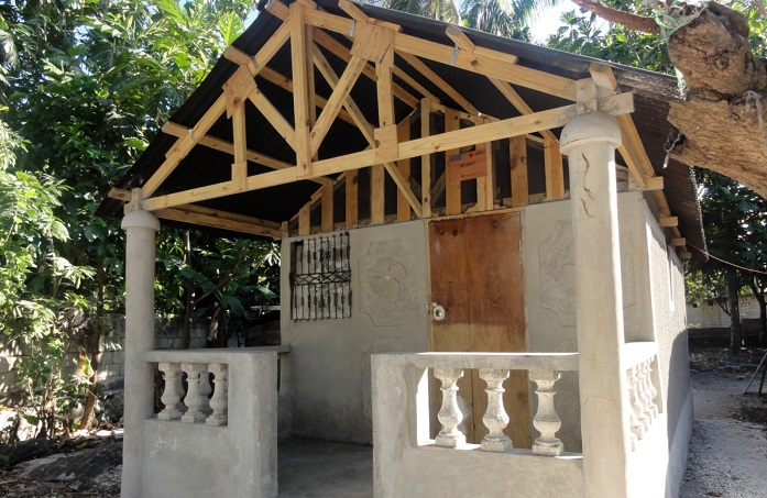 a shelter that has been reinforced with concrete in Haiti