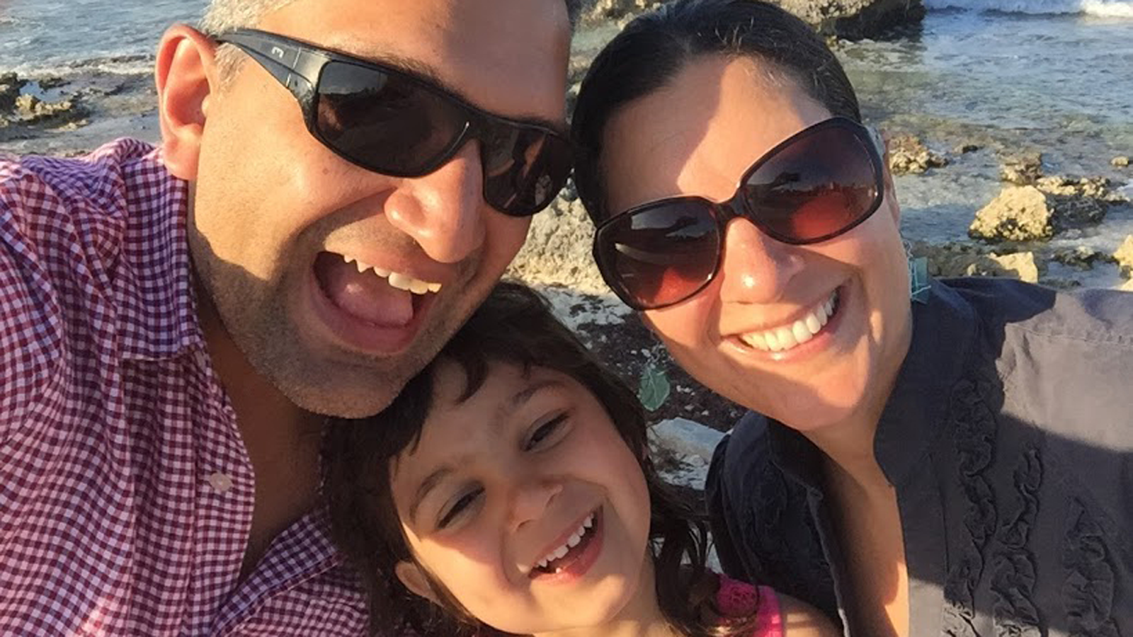 Ajay Kapoor and Gina Febbaro with their daughter Priya in Mexico