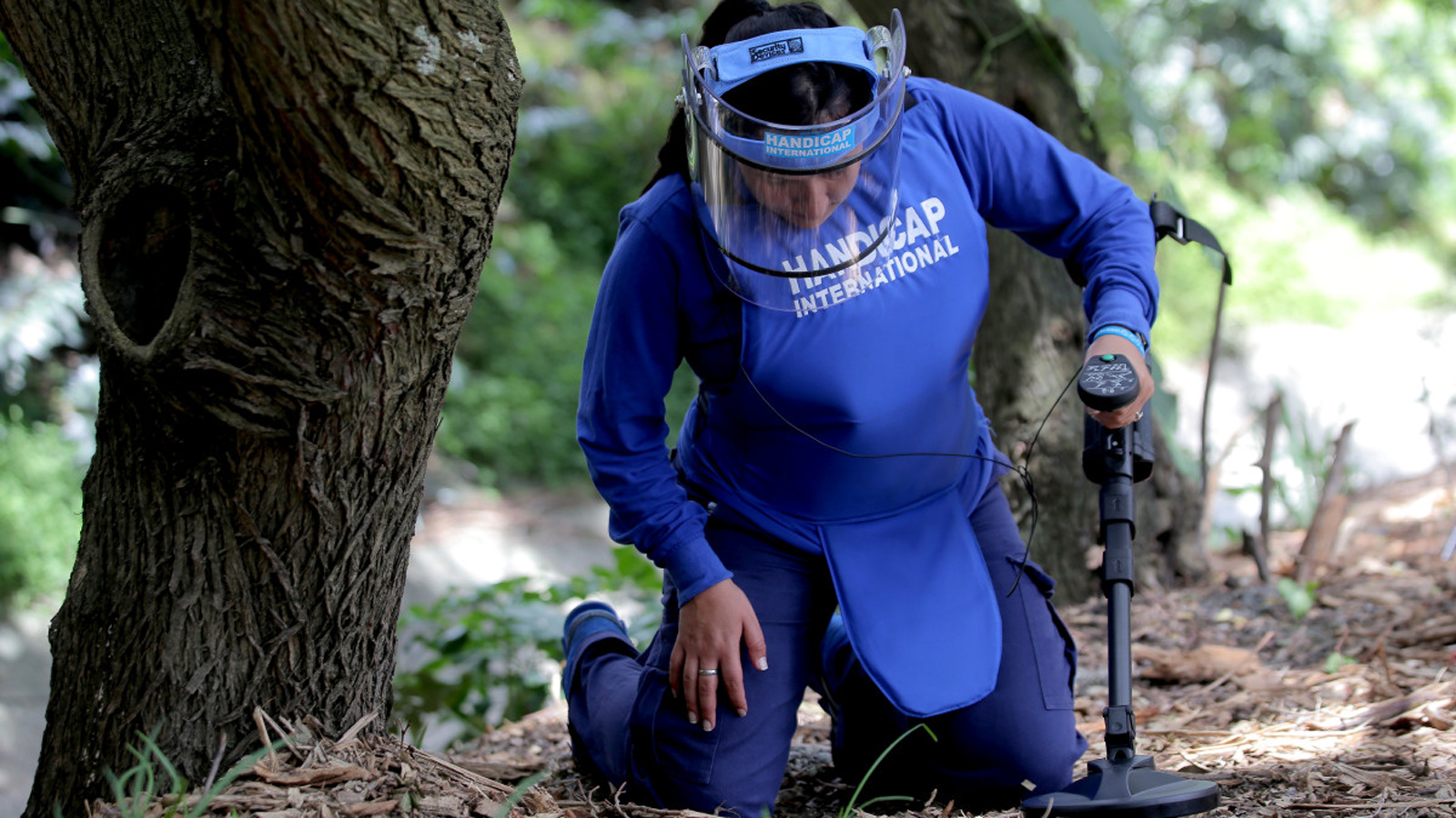 A female deminer trains for operations in Colombia