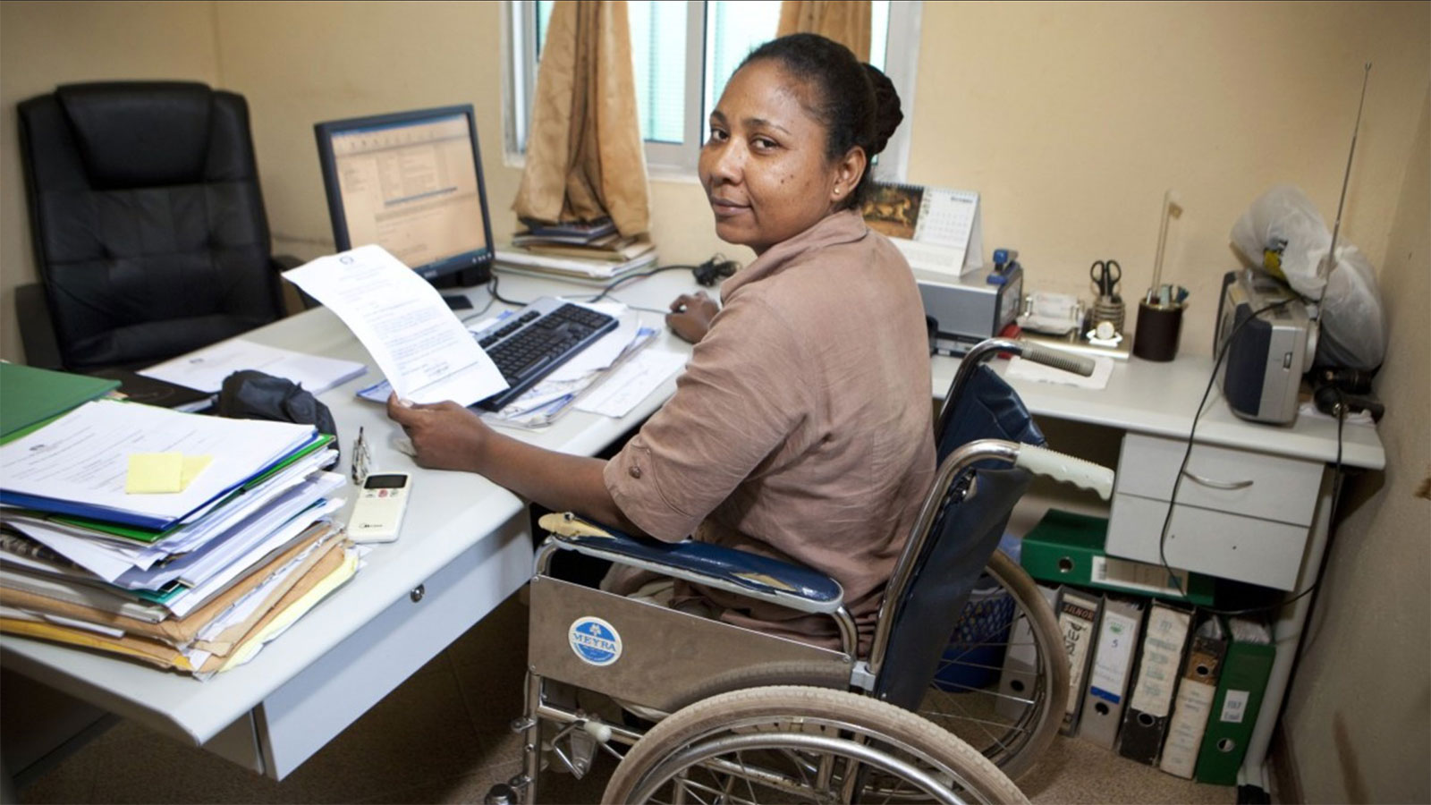 woman-working-in-office-in-Angola
