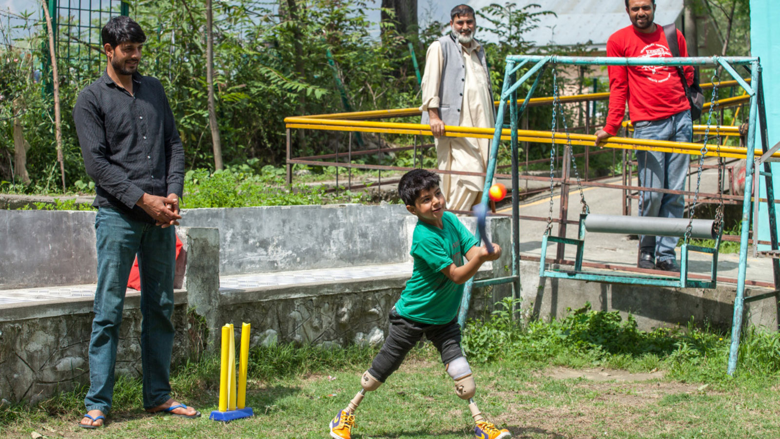 Fayaz who lost both of his legs from an explosive remnant of war in India plays cricket with his friends.