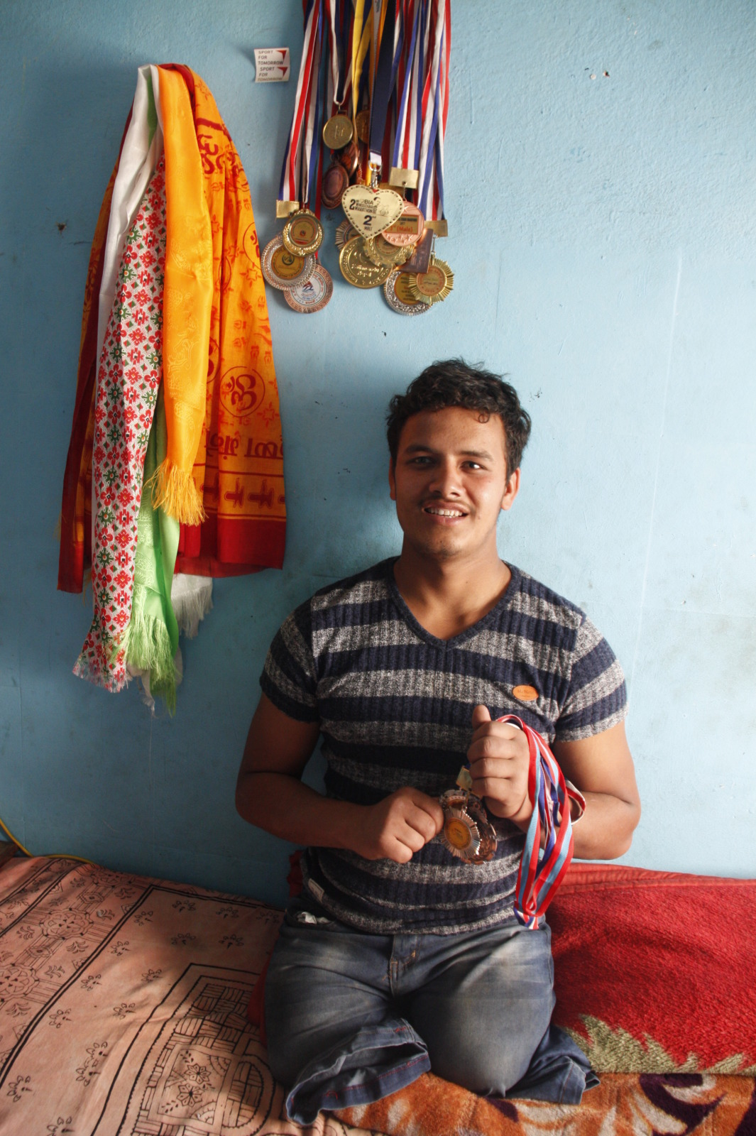 Ramesh_with_his_medals_in_Nepal.JPEG