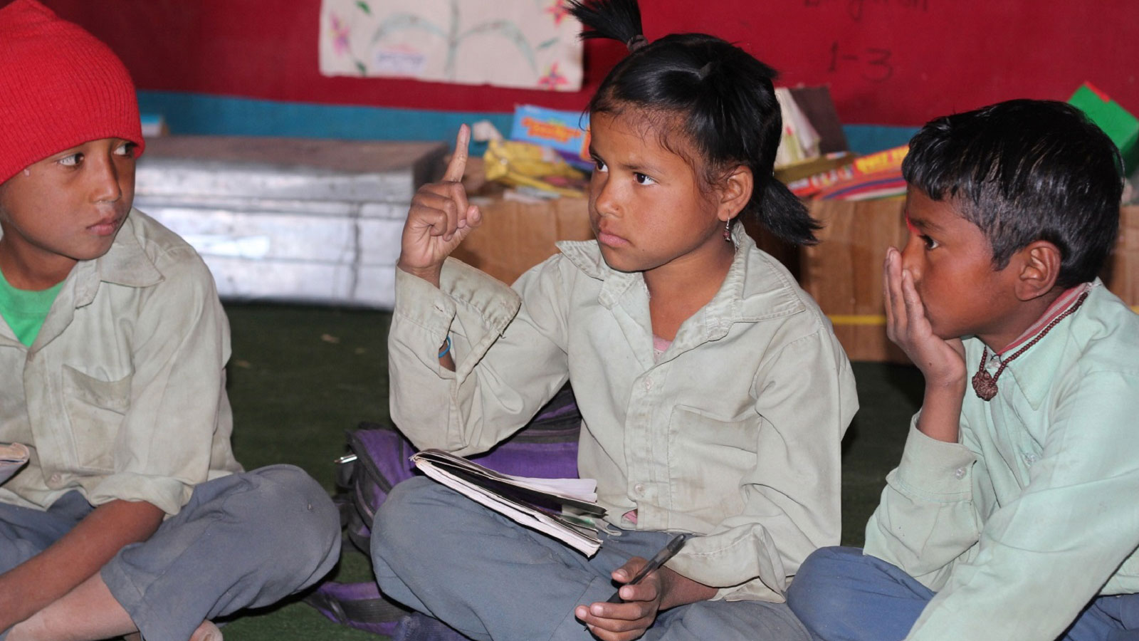 Children with little or no hearing read in an inclusive classroom in Nepal %281%29