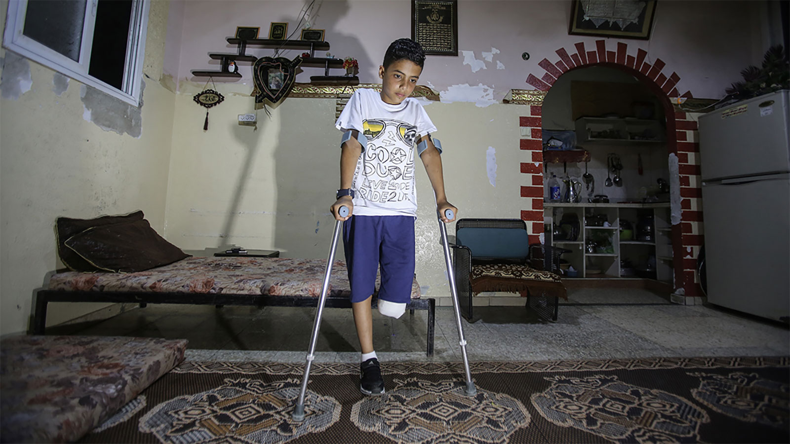 "A 11-year-old boy, who lost his leg after Israeli soldiers opened fire on ""Great March of Returns"" demonstrations at Gaza Strip, is seen with his crutch in Gaza City, Gaza on May 12, 2018."