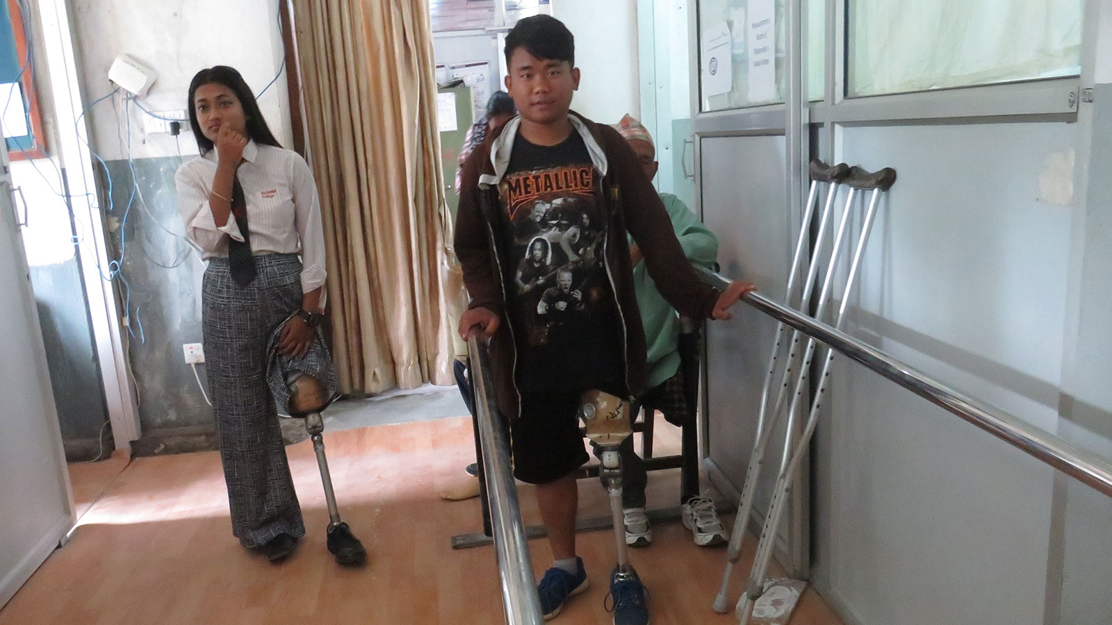 Two-beneficiaries-of-the-Nepal-quake-try-on-new-prosthetics-at-a-rehab-center-in-Nepal-which-is-supported-by-HI