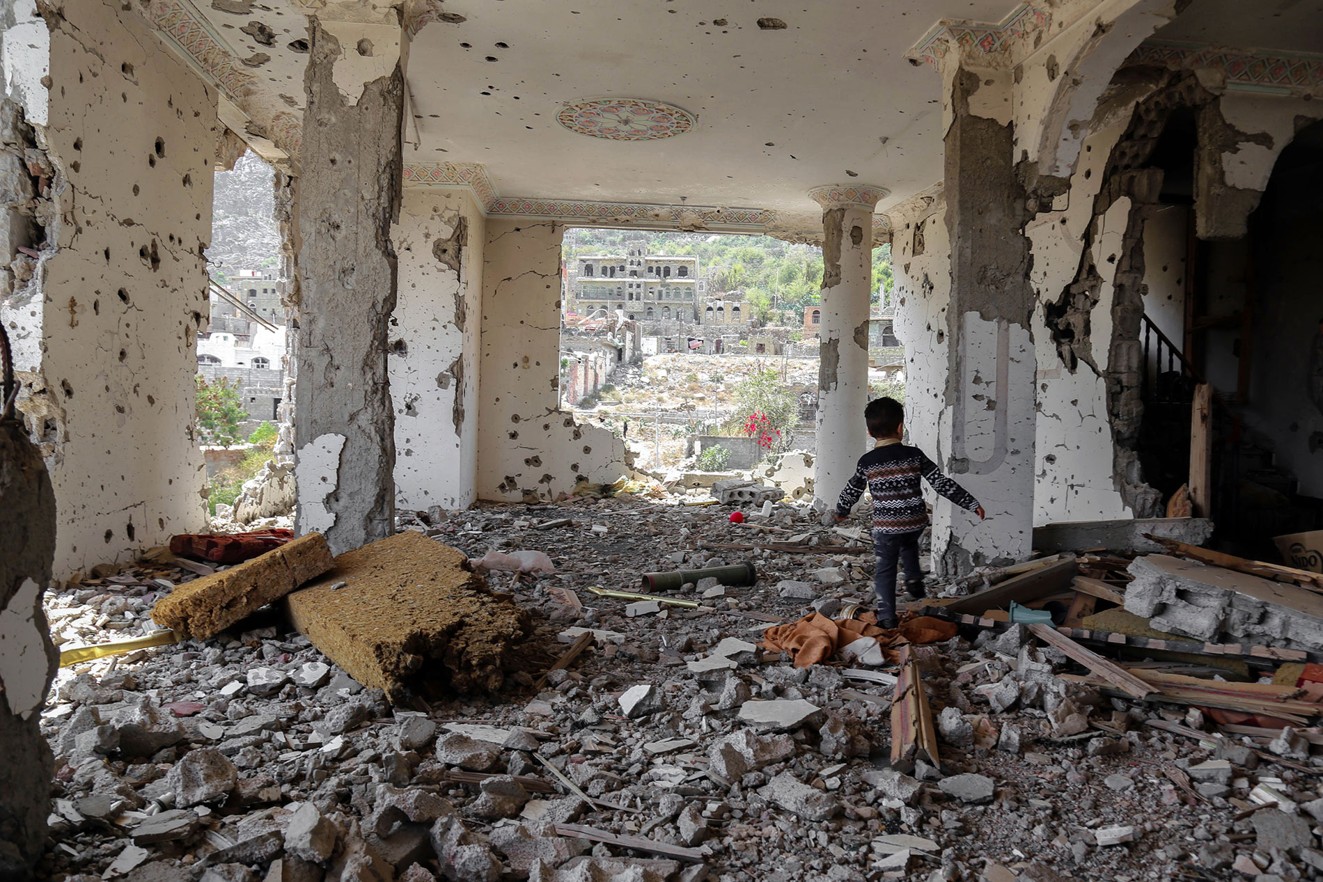 c_Ahmad-AlBasha_AFP__A-Yemeni-child-walking-in-the-rubble-of-a-building-that-was-destroyed-in-an-air-strike-in-the-southern-Yemeni-city-of-Taez.-March-2018.jpg