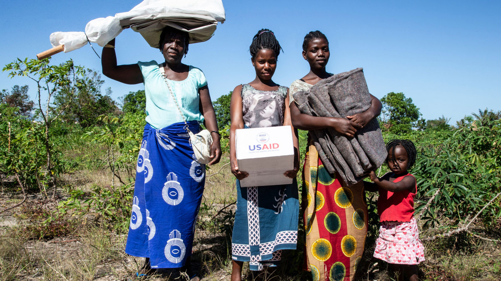 A-family-receives-humanitarian-aid-following-Cyclone-Idai-in-Mozambique