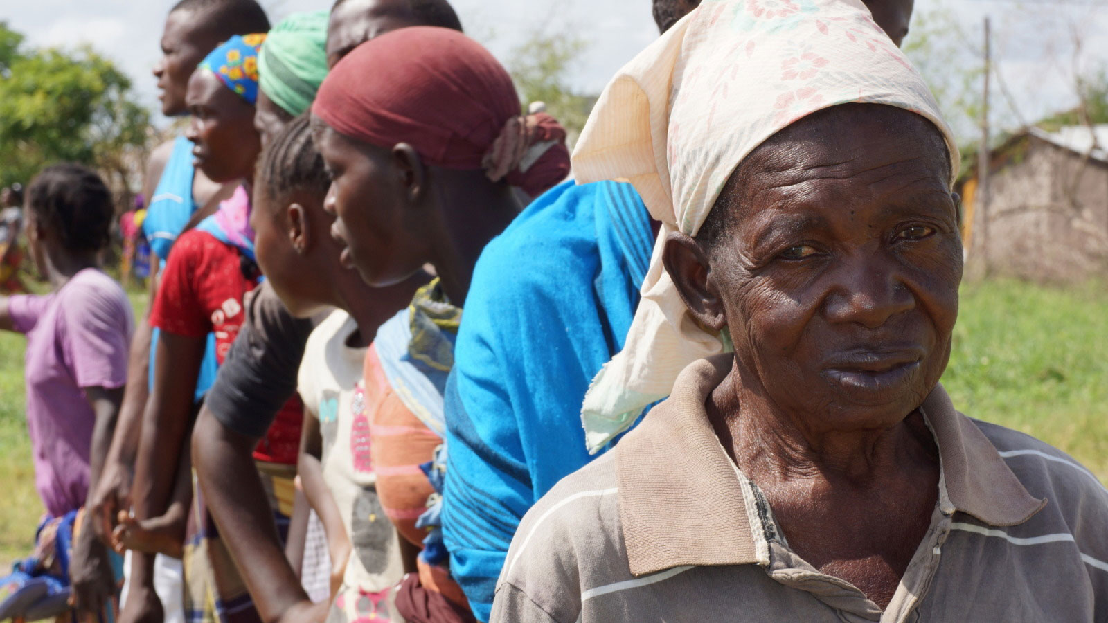 An-older-man-stands-in-line-waiting-for-humanitarian-aid-following-Cyclone-Idai-in-Mozambique