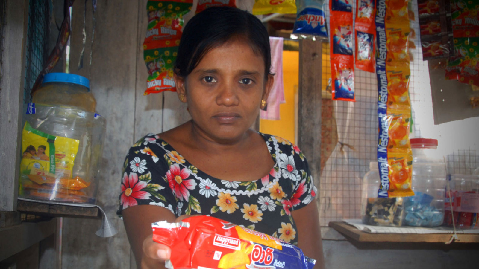 A-woman-with-a-disability-in-Sri-Lanka-sells-items-at-a-stand-thanks-to-support-she-received-from-HI's-inclusive-livelihoods-project