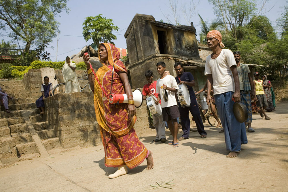 Bhabani Rout, 45, who wears a prosthetic leg, leads an early warning mock drill in India.