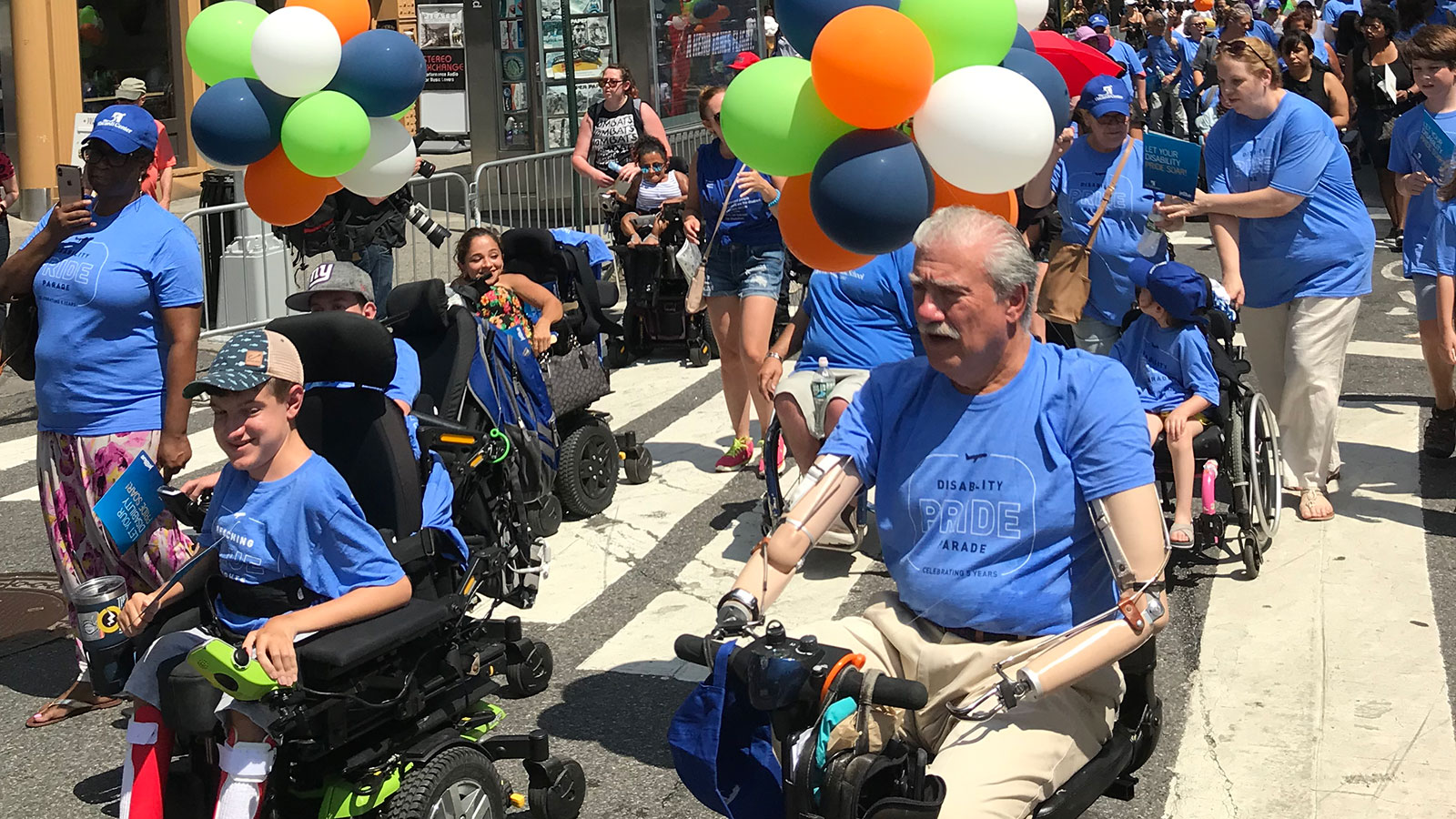 People-with-disabilities-march-in-the-disability-pride-parade-in-NYC-in-July-2019