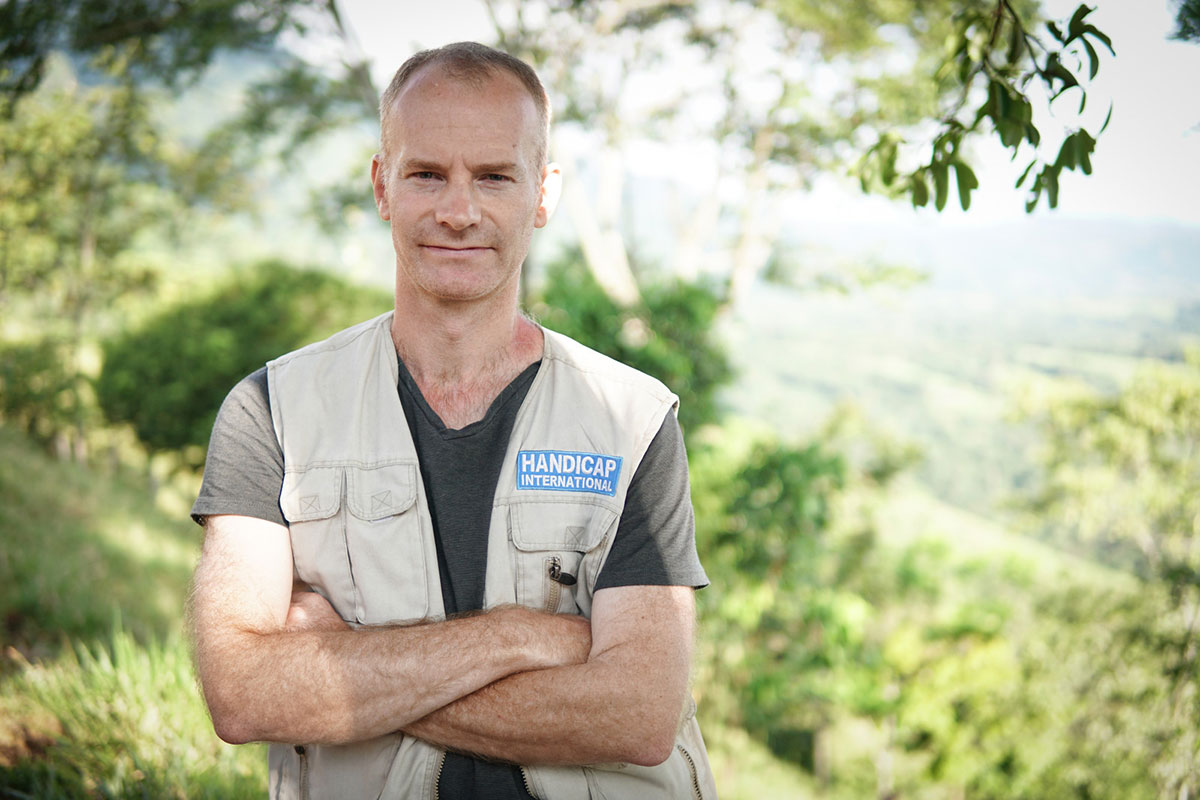 c_HI__Gregory-Le-Blanc-stands-in-a-field-in-Colombia-wearing-an-old-HI-vest.jpg